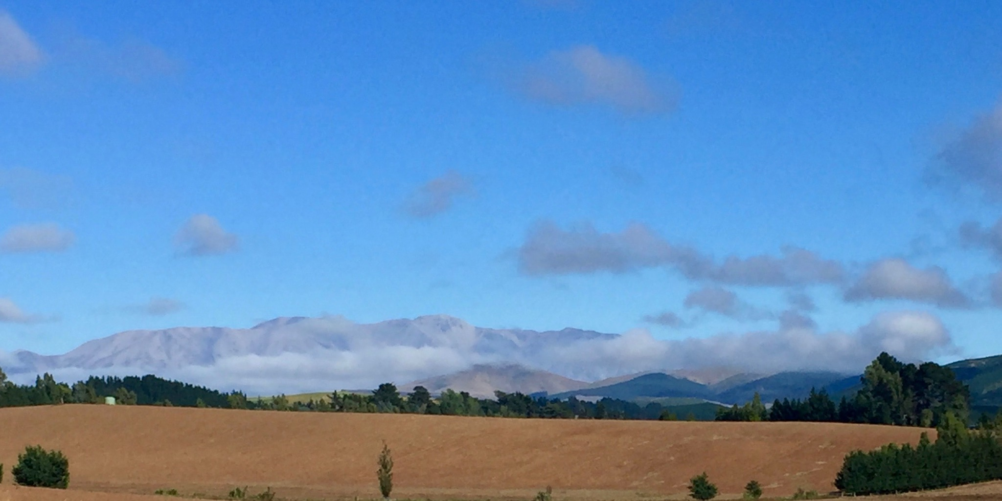 As the clouds lifted we could see the mountains.